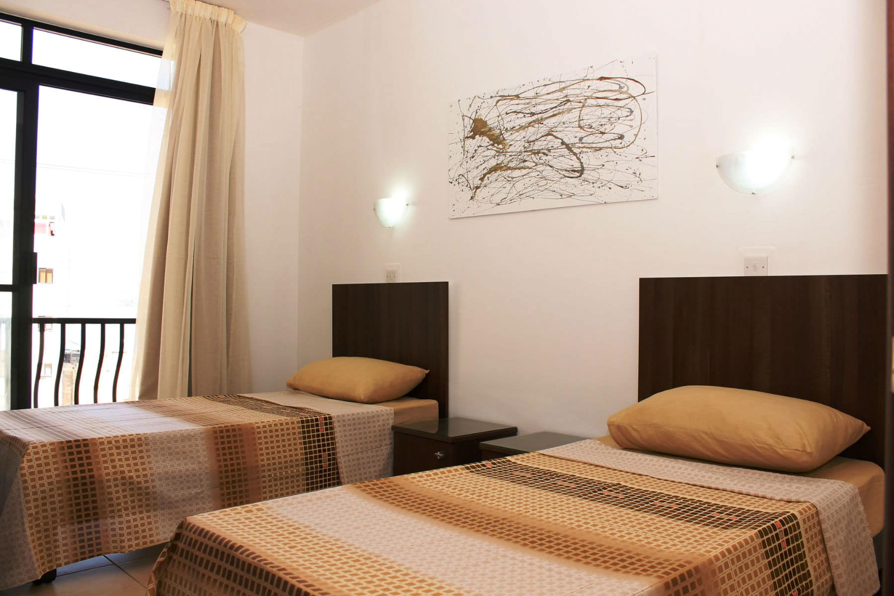 Seashells Holiday Apartments Main bedroom with twin beds with space for a 3rd bed