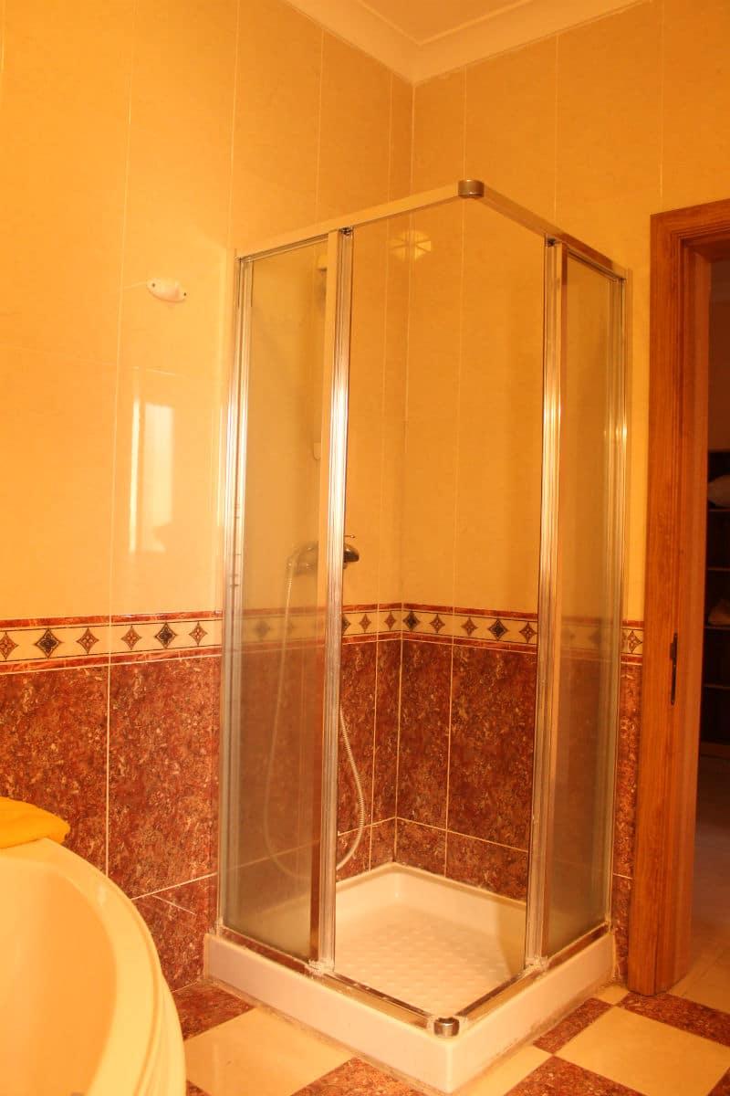 Bathroom with shower and corner bath.-w1920-h1200