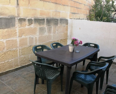 back terrace with outdoor furniture and BBQ.-w1920-h1200