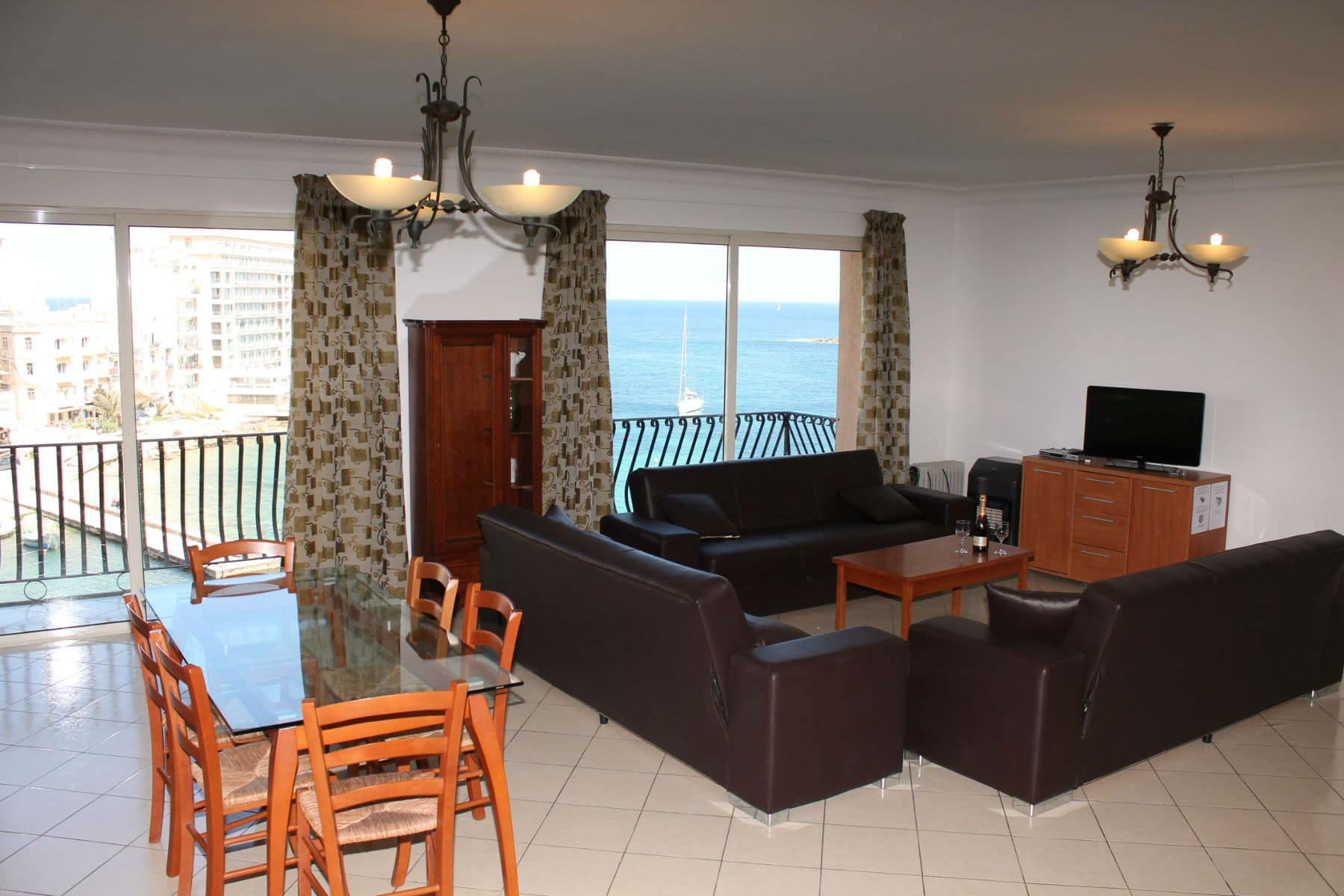 dining living area with 2 sea front balconies-w1920-h1200-w1920-h1200
