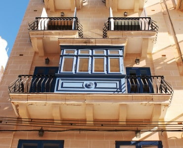 facade of building with Maltese architecture features - Copy