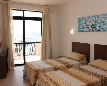 Main bedroom with twin beds Sea view Holiday penthouse