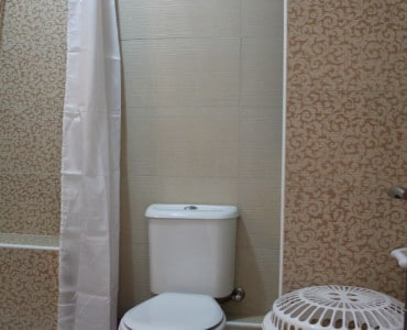 Shower room Main bedroom with twin beds Sea view Holiday penthouse