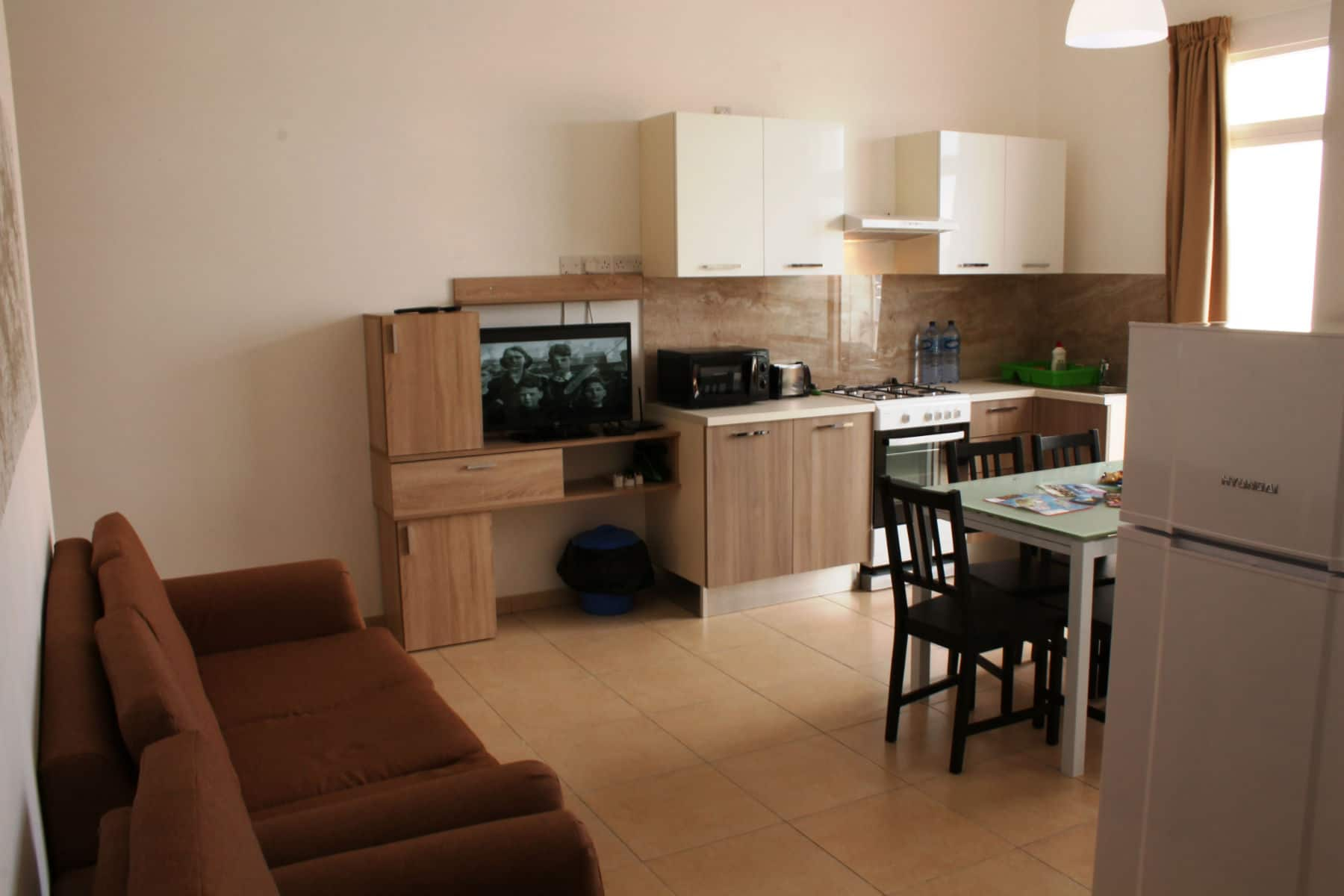 Brand New Kitchen/Living/Dining Fast Wifi (internet) and Over 700 TV channels. Seafront holiday apartment with terrace