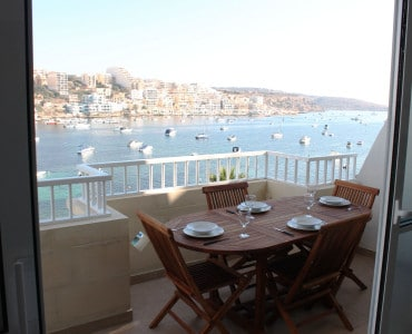 Amazing Front Terrace with Outdoor Furniture and Gas BBQ. Big Seafront holiday apartment Seafront 3 bedroom self catering holiday apartment with seafront terrace