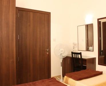 Main bedroom with waldrobe, vanity desk, fan and hairdryer-w1920-h1200